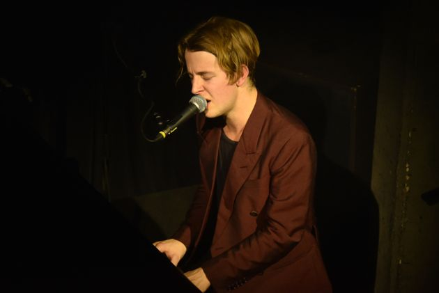 LONDON, ENGLAND - DECEMBER 14: Tom Odell performs for Help Refugees at their annual Christmas party at...