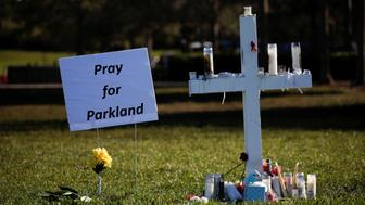 A cross commemorating the victims of the shooting at Marjory Stoneman Douglas High School is seen in a park in Parkland, Florida, U.S., February 16, 2018. REUTERS/Carlos Garcia Rawlins