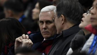 US Vice President Mike Pence (L) talks to South Korea's President Moon Jae-in during the short track speed skating event during the Pyeongchang 2018 Winter Olympic Games, at the Gangneung Ice Arena in Gangneung on February 10, 2018. / AFP PHOTO / ARIS MESSINIS        (Photo credit should read ARIS MESSINIS/AFP/Getty Images)