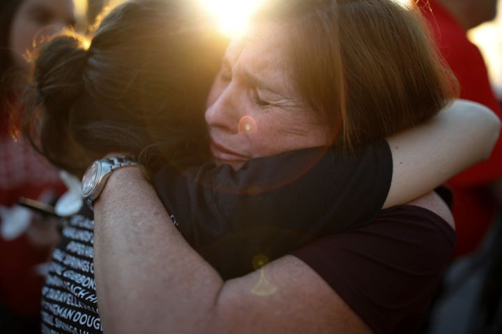 A shared embrace during the candlelight vigil for victims of the mass shooting at Marjory Stoneman Douglas High School in Par