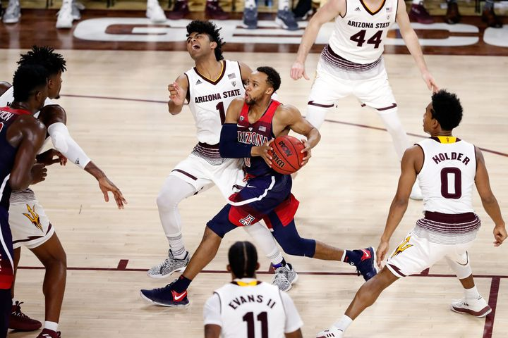 A cheerleader was tossed for razzing Arizona State's Remy Martin (No. 1, pictured on defense) as he shot a free throw in the