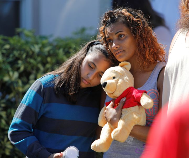 Mourners attend a community prayer vigil for victims of the shooting at Marjory Stoneman Douglas High School in Parkland, Florida, on Feb. 15, 2018.
