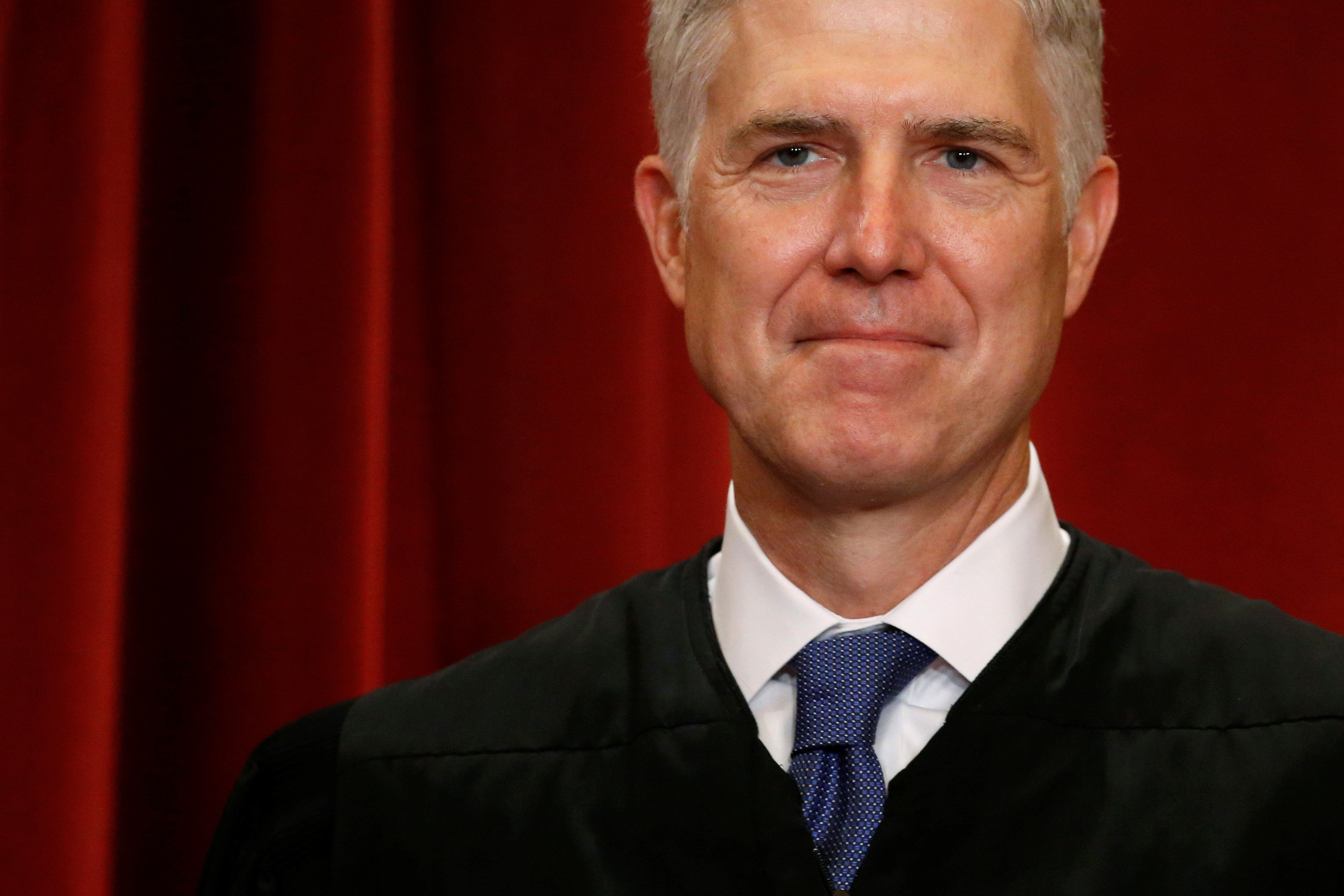 U.S. Supreme Court Justice Neil Gorsuch participates in taking a new family photo with his fellow justices at the Supreme Court building in Washington, D.C., U.S., June 1, 2017. REUTERS/Jonathan Ernst