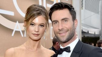 BEVERLY HILLS, CA - JANUARY 11:  72nd ANNUAL GOLDEN GLOBE AWARDS -- Pictured: (l-r) Model Behati Prinsloo and recording artist Adam Levine arrive to the 72nd Annual Golden Globe Awards held at the Beverly Hilton Hotel on January 11, 2015.  (Photo by Alberto Rodriguez/NBC/NBC via Getty Images)