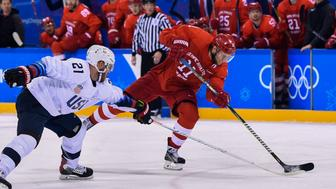 US James Wisniewski and Russia's Sergei Andronov vie for the puck in the men's ice hockey preliminary round group B game between the Olympic Athletes from Russia and the United States during the Pyeongchang 2018 Winter Olympic Games at the Gangneung Hockey Centre in Gangneung on February 17, 2018. / AFP PHOTO / Brendan Smialowski        (Photo credit should read BRENDAN SMIALOWSKI/AFP/Getty Images)