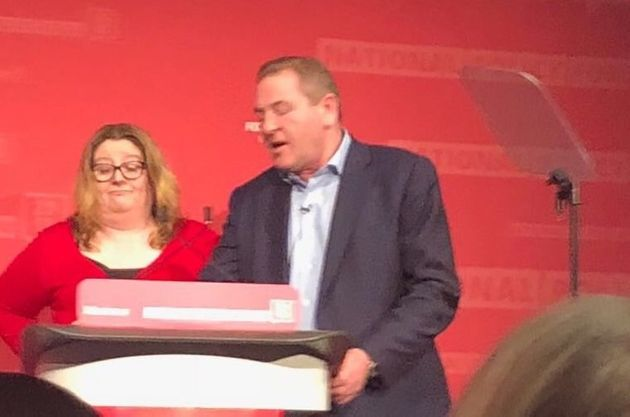 NEC chair Andy Kerry takes over the lectern from a bemused Katrina
