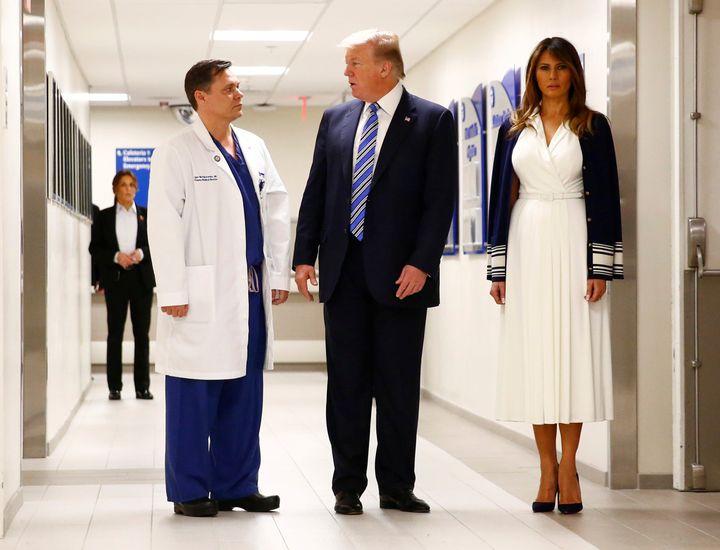 Donald and Melania Trumptalk to Dr. Igor Nichiporenko a trauma surgeon at Broward Health North Hospital in the wake of