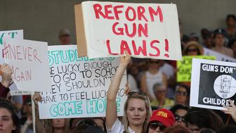 FORT LAUDERDALE, FL - FEBRUARY 17:  People join together after a school shooting that killed 17 to protest against guns on the steps of the Broward County Federal courthouse on February 17, 2018 in Fort Lauderdale, Florida. Earlier this week former student Nikolas Cruz opened fire with a AR-15 rifle at the Marjory Stoneman Douglas High School killing 17 people.  (Photo by Joe Raedle/Getty Images)