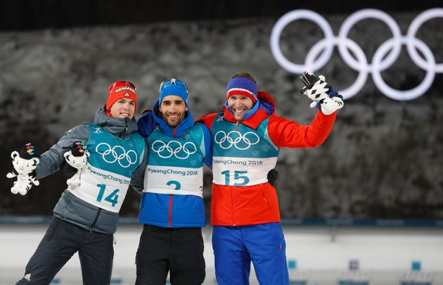 From left: Silver medalist Simon Schempp of Germany, gold medalist Martin Fourcade of France, and bronze...
