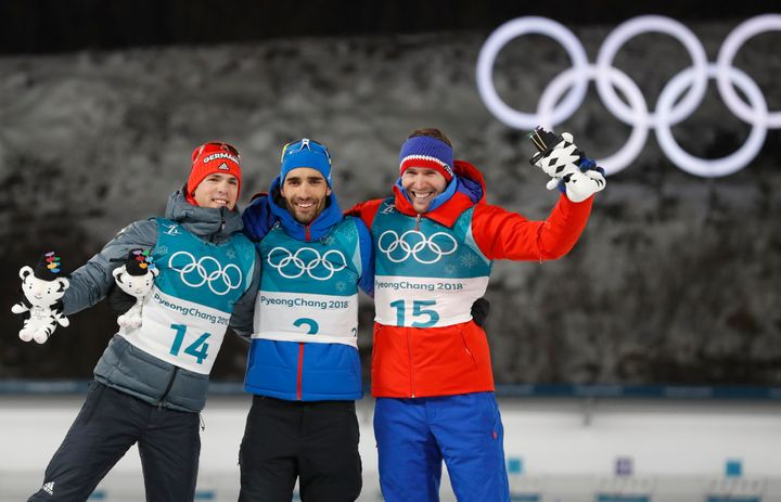From left: Silver medalist Simon Schempp of Germany, gold medalist Martin Fourcade of France, and bronze medalist Emil Hegle Svendsen of Norway celebrate duringSunday's victory ceremony.