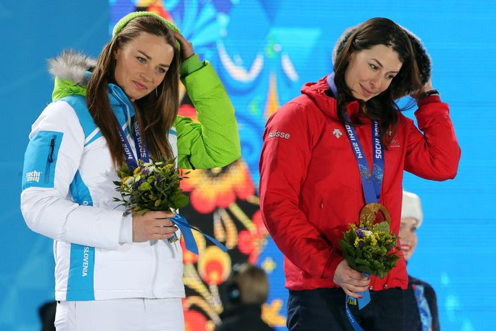 Gold medalists Switzerland's Dominique Gisin (R) and Slovenia's Tina Maze pose on the podium during the Women's Alpine Skiing