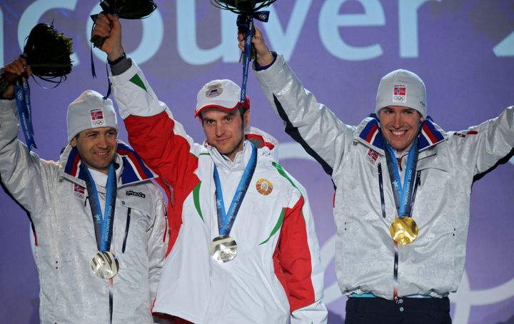Gold medalist Norway's Emil Hegle Svendsen (R) and silver medalists Norway's Ole Einar Bjoerndalen (L) and Belaru