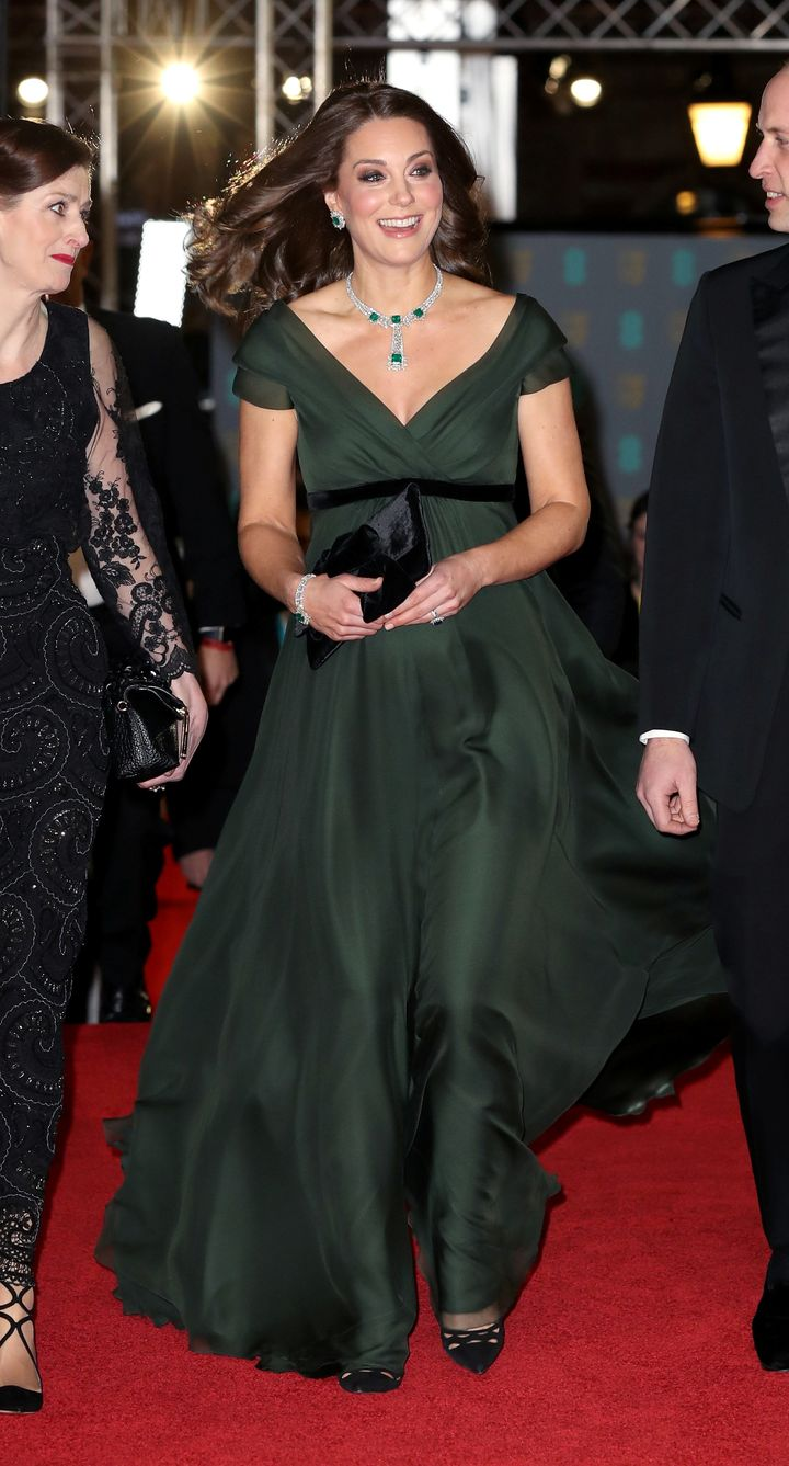 The Duchess of Cambridge turns up in green — with a black belt — at the BAFTA awards.
