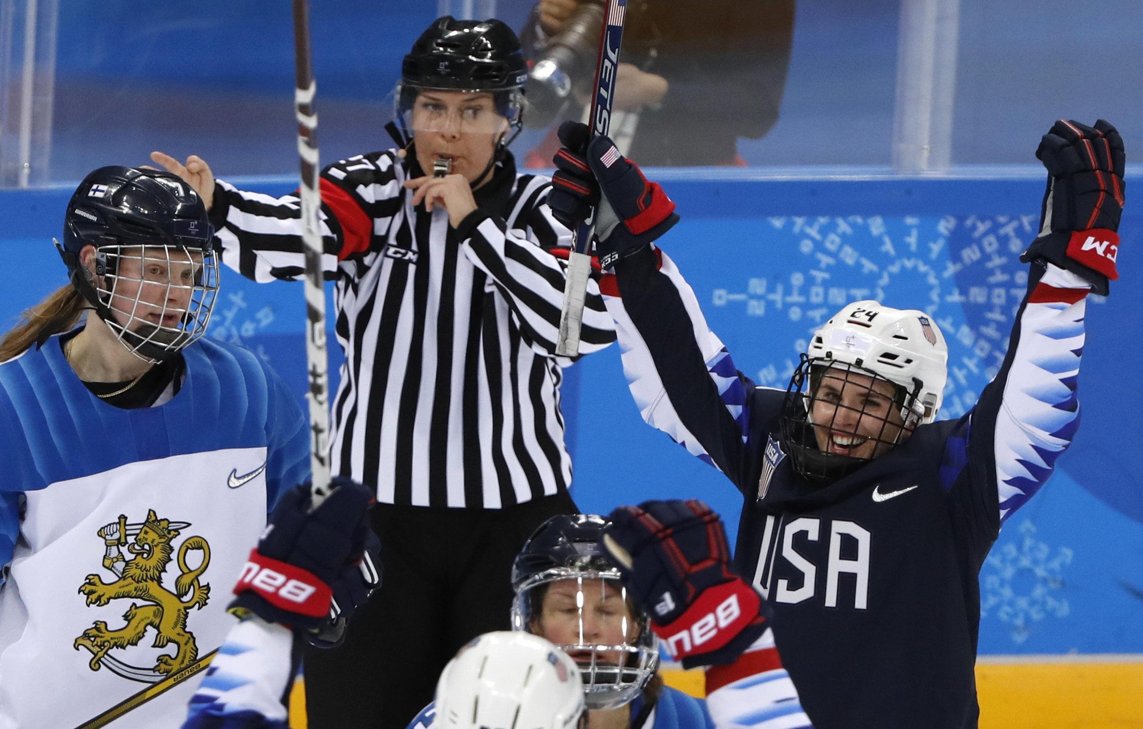 Danielle Cameranesi. right, of the U.S. celebrates scoringa goal against Finlandduring the women's ice hockey sem