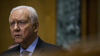 Senator Orrin Hatch, a Republican from Utah, speaks during a Senate Finance Committee hearing in Washington, D.C., U.S., on Wednesday, Feb. 14, 2018. U.S. Treasury secretary Steven Mnuchinsaid the Internal Revenue Service will issue guidance within the next two weeks to prevent hedge-fund managers from dodging new tax rules on carried-interest profits. Photographer: Zach Gibson/Bloomberg via Getty Images