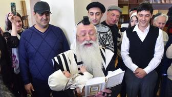 PYATIGORSK, RUSSIA - DECEMBER 8, 2016: A Jewish religious male circumcision ceremony performed by the Stavropol regional Jewish community at the Pyatigorsk synagogue. Anton Podgaiko/TASS (Photo by Anton Podgaiko\TASS via Getty Images)