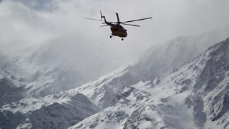 Emergency and rescue helicopter searches for the plane that crashed in a mountainous area of central Iran, February 19, 2018. REUTERS/Tasnim News Agency  ATTENTION EDITORS - THIS PICTURE WAS PROVIDED BY A THIRD PARTY.