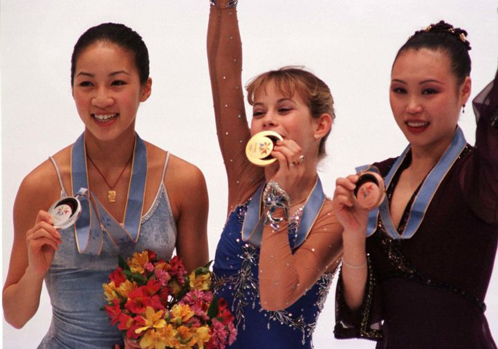 Michelle Kwan and Tara Lipinski of the U.S. and Lu Chen of China with their Olympic medals in Nagano.