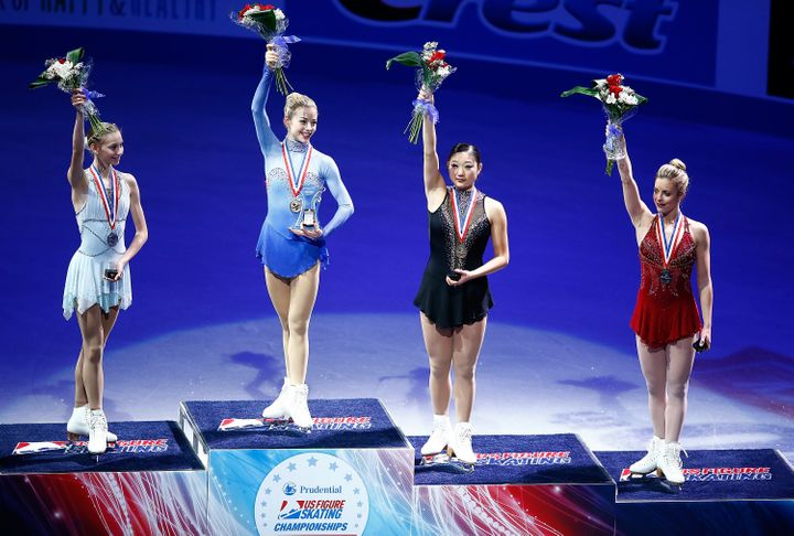 Polina Edmunds, Grace Gold, Mirai Nagasu and Ashley Wagner on the podium during the 2014 U.S. Figure Skating Championships.