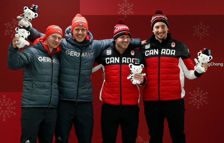 Francesco Friedrich (far left) and Thorsten Margis of Germany shared gold medals on Monday with Alexander Kopacz (far right)
