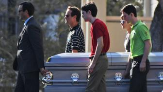 Pallbearers walk the casket of Scott Beigel, a teacher at Marjory Stoneman Douglas High School who was killed in the mass shooting, to his final resting place at Temple Beth El in Boca Raton, Fla. on Sunday, Feb. 18, 2018. (Jim Rassol/Sun Sentinel/TNS via Getty Images)