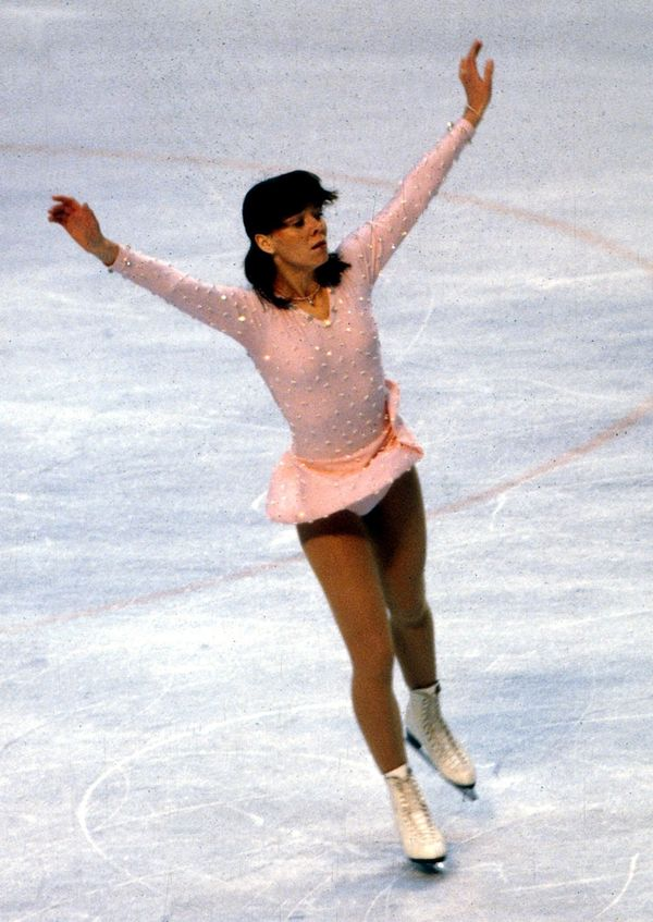 The West German skater performing at the 1980 Winter Olympics in Lake Placid, New York.