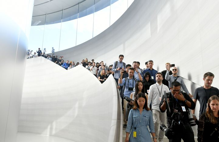 Members of the media enter the Steve Jobs Theater at Apple's new headquarters ahead of new product announcements in Cupertino