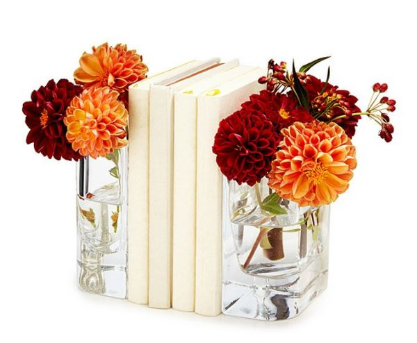 "Get them <a href=""https://www.uncommongoods.com/product/vase-bookends"" target=""_blank"">here</a>."