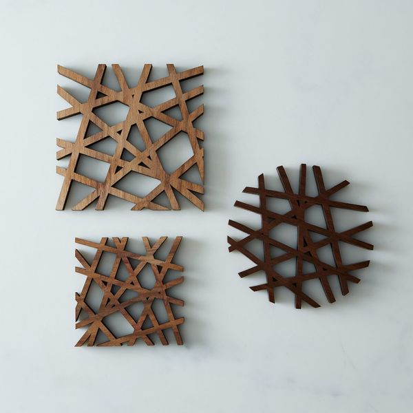 "Get them <a href=""https://food52.com/shop/products/296-mid-century-modern-trivet"" target=""_blank"">here</a>."