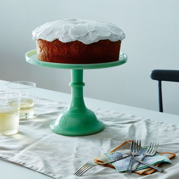 "Get it <a href=""https://food52.com/shop/products/458-jadeite-glass-cake-stand"" target=""_blank"">here</a>."