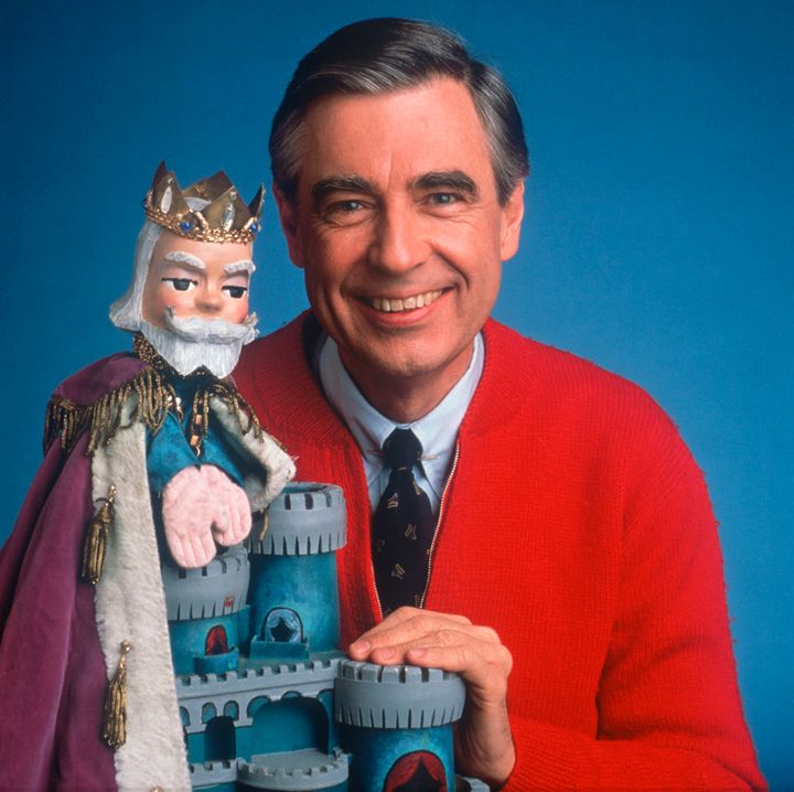 Fred Rogers with King Friday, one of the puppet characters from his show.