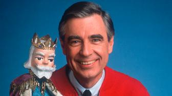 "After more than 30 years of greeting youngsters each day on television with his trademark ""Hi, neighbor,"" Fred Rogers, shown in this undated publicity photograph with character ""King Friday"" is putting away his cardigan and sneakers for good. His show, ""Mister Rogers' Neighborhood,"" will continue to appear on TV's Public Broadcasting System for years to come in re-runs, but the final original episodes of the show will air this week on PBS.  FSP"