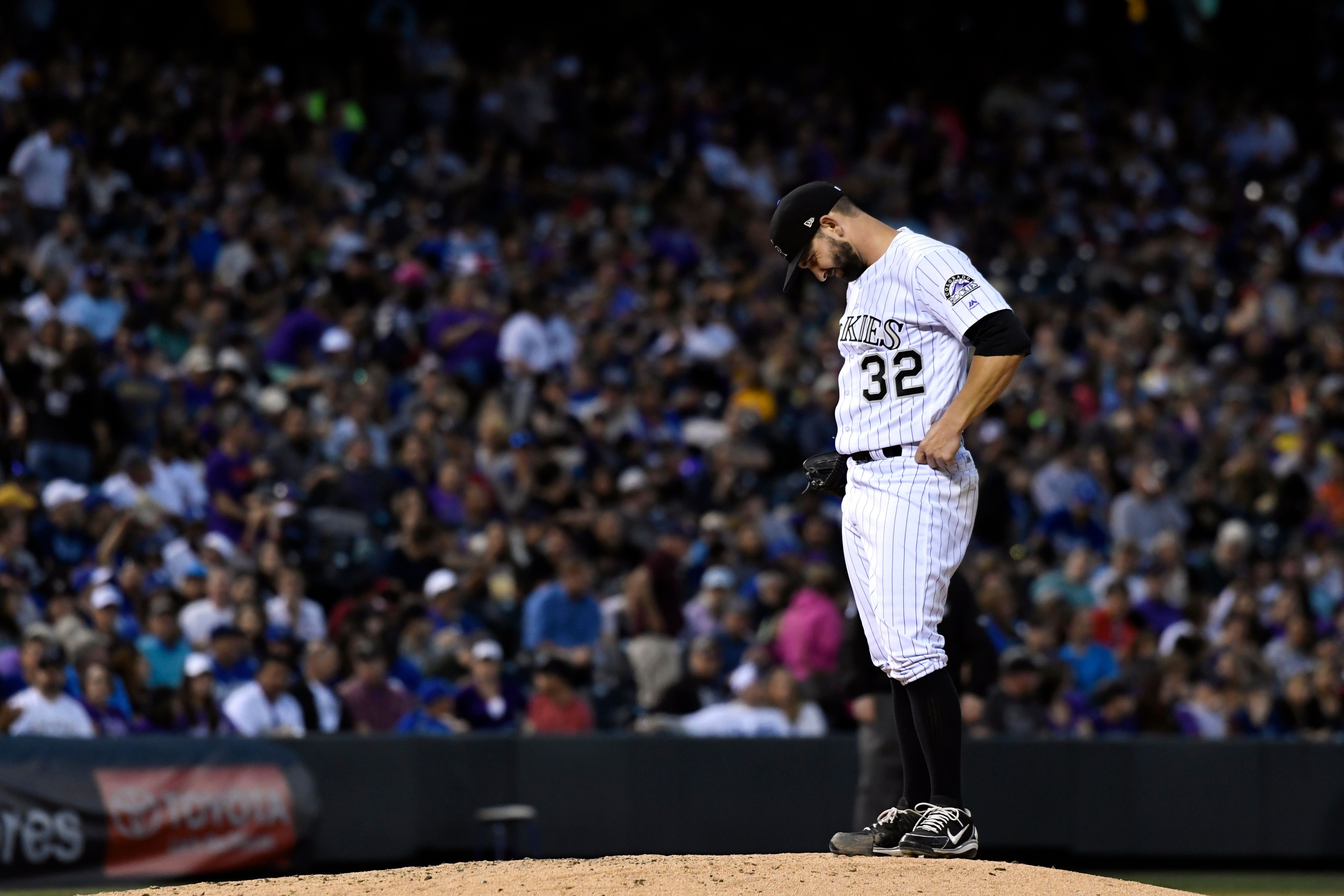 DENVER, CO - MAY 12: Colorado Rockies starting pitcher Tyler Chatwood (32) puts his head down as he waits for Colorado Rockies manager Bud Black to visit the mound in the fifth inning against the Los Angeles Dodgers on May 12, 2017 in Denver, Colorado at Coors Field. Black pulled Chatwood in the inning. (Photo by John Leyba/The Denver Post via Getty Images)