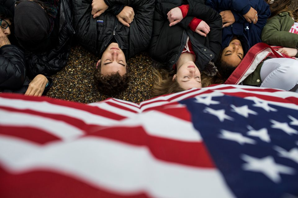 Protesters lie on the ground during a demonstration supporting gun control.