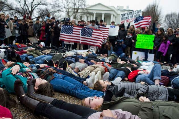 Demonstrators on the ground during a lie-in demonstration supporting gun control reform on