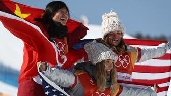 PYEONGCHANG-GUN, SOUTH KOREA - FEBRUARY 13:  (L-R) Silver medalist Jiayu Liu of China, gold medalist Chloe Kim of the United States and bronze medalist Arielle Gold of the United States pose during the victory ceremony for the Snowboard Ladies' Halfpipe Final on day four of the PyeongChang 2018 Winter Olympic Games at Phoenix Snow Park on February 13, 2018 in Pyeongchang-gun, South Korea.  (Photo by Clive Rose/Getty Images)