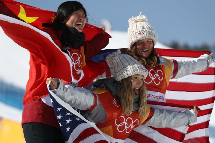 Silver medalist Jiayu Liu of China, gold medalist Chloe Kim of the United States, center, and bronze medalist Arielle Gold of