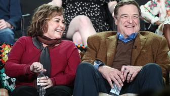 PASADENA, CA - JANUARY 08:  Executive producer/actress Roseanne Barr (L) and actor John Goodman of the television show Roseanne react onstage during the ABC Television/Disney portion of the 2018 Winter Television Critics Association Press Tour at The Langham Huntington, Pasadena on January 8, 2018 in Pasadena, California.  (Photo by Frederick M. Brown/Getty Images)