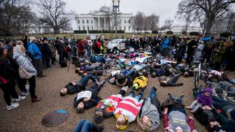UNITED STATES - FEBRUARY 19: Washington, D.C., area students and supporters protest against gun violence with a lie-in outside of the White House on Monday, Feb. 19, 2018, after 17 people were killed in a shooting at Marjory Stoneman Douglas High School in Parkland, Fla., last week. (Photo By Bill Clark/CQ Roll Call)
