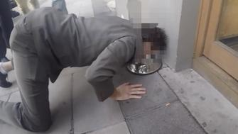 A freshie at Newcastle University is forced to drink from a dog bowl in public
