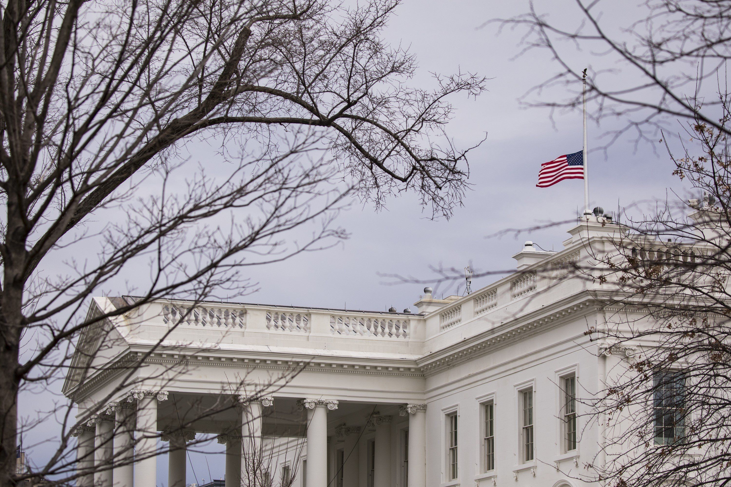 WASHINGTON, USA - FEBRUARY 15: The American flag flies at half staff over the White House in remembrance of those killed in the mass shooting at Marjory Stoneman Douglas High School in Parkland, Fla. in Washington, USA on February 15, 2018. Former student Nikolas Cruz has been apprehended and charged with 17 counts of premeditated murder after attacking his former school with an AR-15 style rifle. (Photo by Samuel Corum/Anadolu Agency/Getty Images)