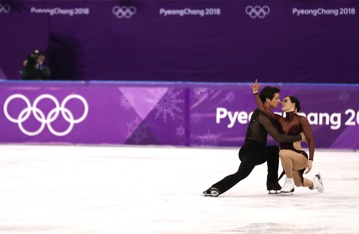 Canadians Tessa Virtue and Scott Moir won a gold medal in the ice dance Tuesday, their fifth Olympic medal overall.