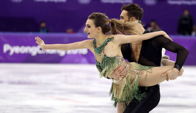 Guillaume Cizeron and Gabriella Papadakis of France perform at the Ice Dance Short Dance competition...