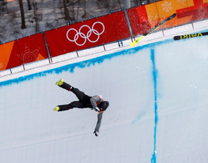 Joel Gisler falls after crashing during the halfpipe event.