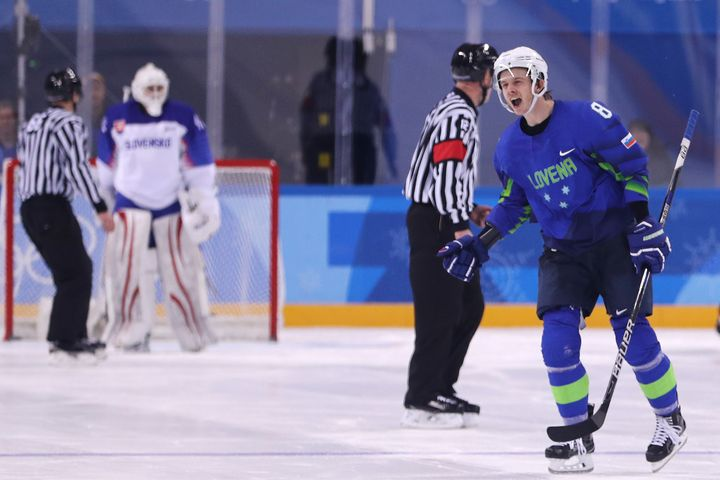 Ziga Jeglic #8 of Slovenia celebrates after scoring the winning goal in a shootout against Slovakia during the Men's Ice Hock