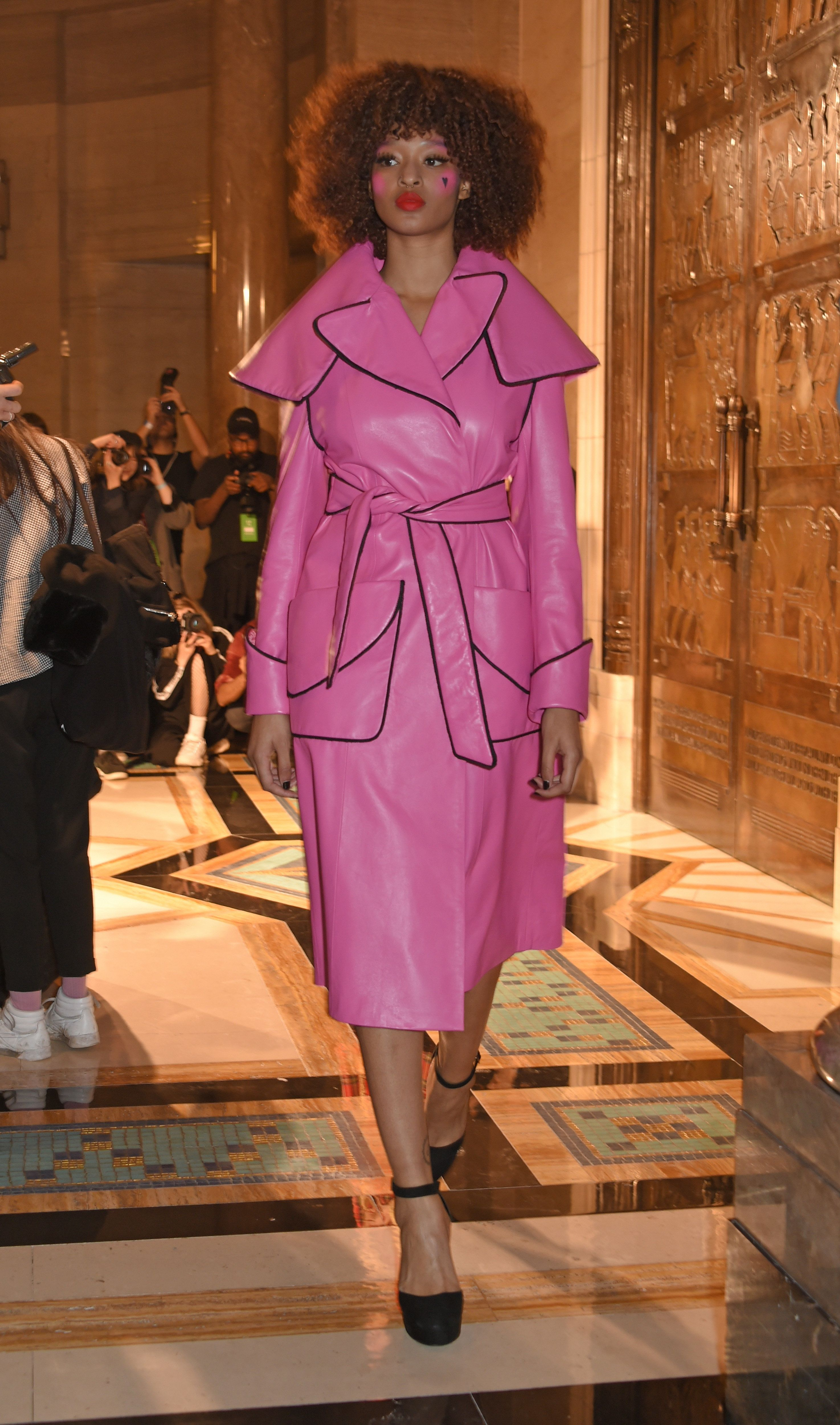 Pam Hogg showed us how it's done with this hot pink leather coat during her show this London Fashion Week.