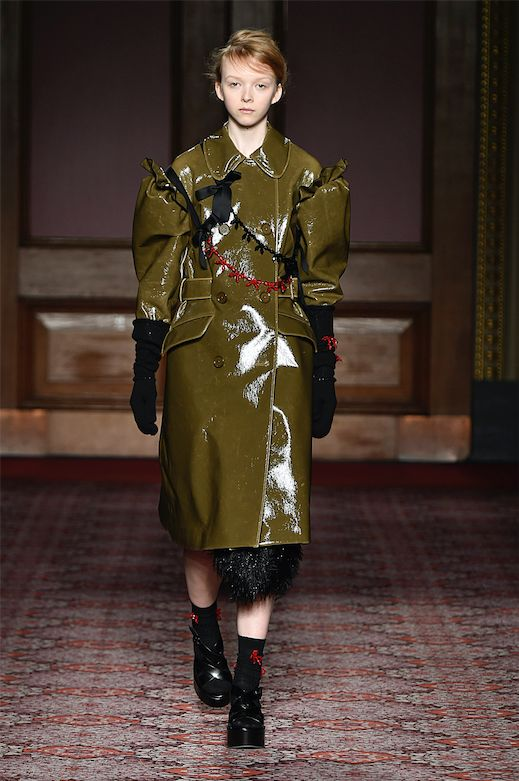 Simone Rocha's green rain coat gives a nod to Victoriana ruffles while tooting the block trend.