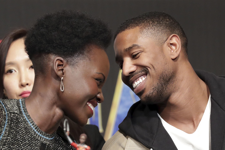 "Lupita Nyong'o and Michael B. Jordan at a press conferencefor the Seoul premiere of ""Black Panther."""
