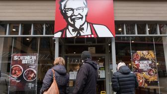 BRISTOL, ENGLAND - FEBRUARY 20:  People look into a branch of KFC that is closed due to problems with the delivery of chicken on February 20, 2018 in Bristol, England. KFC has been forced to close hundred of its outlets as a shortage of chicken, due to a failure at the company's new delivery firm DHL, has disrupted the fast-food giant's UK operation and is thought to be costing the fast food chain £1million a day.  (Photo by Matt Cardy/Getty Images)