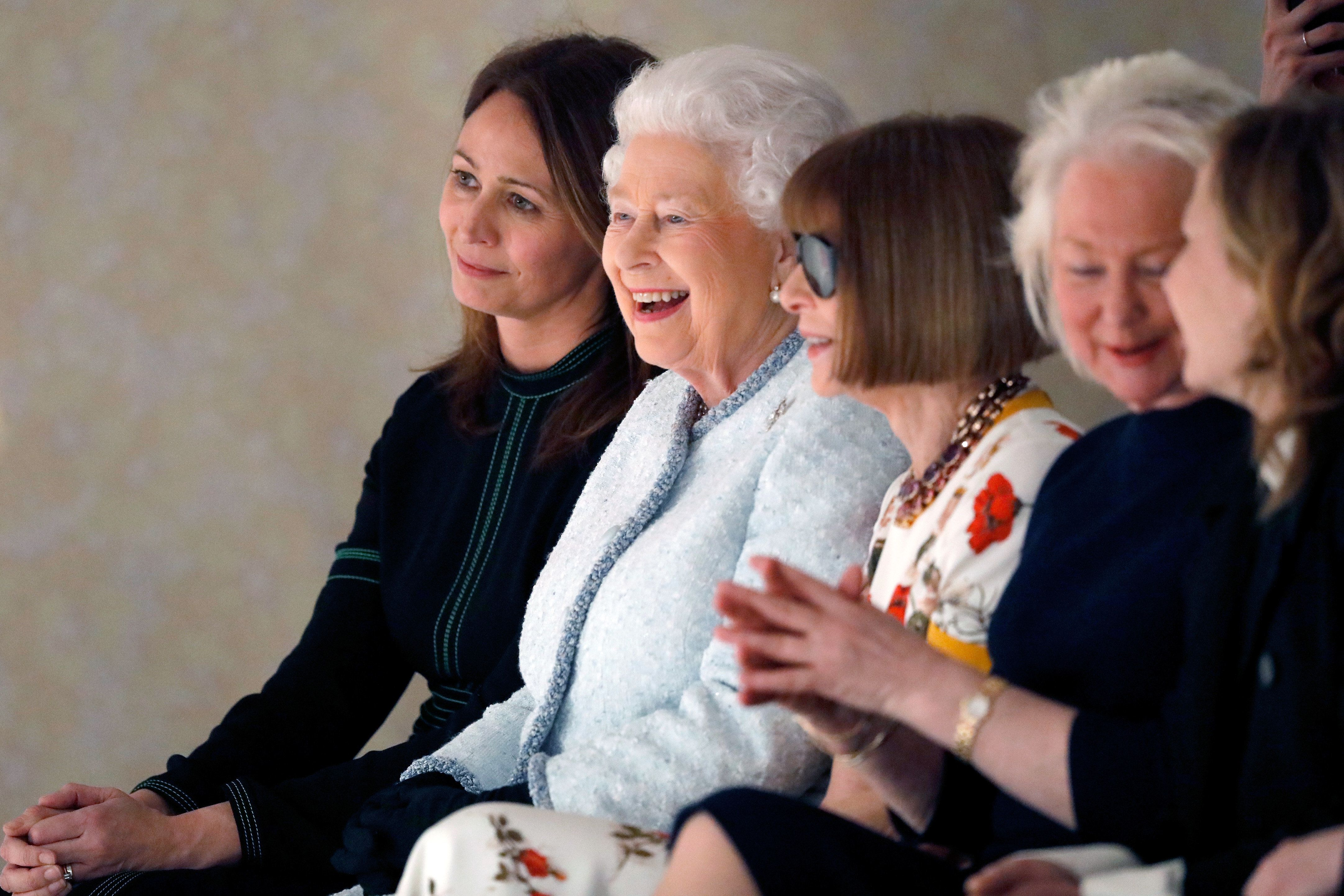 From left, British Fashion Councilchief executive Caroline Rush, Queen Elizabeth II and Vogue Editor-in-Chief Anna Wintour attend the Richard Quinn show during London Fashion Week on Feb. 20, 2018, in London.